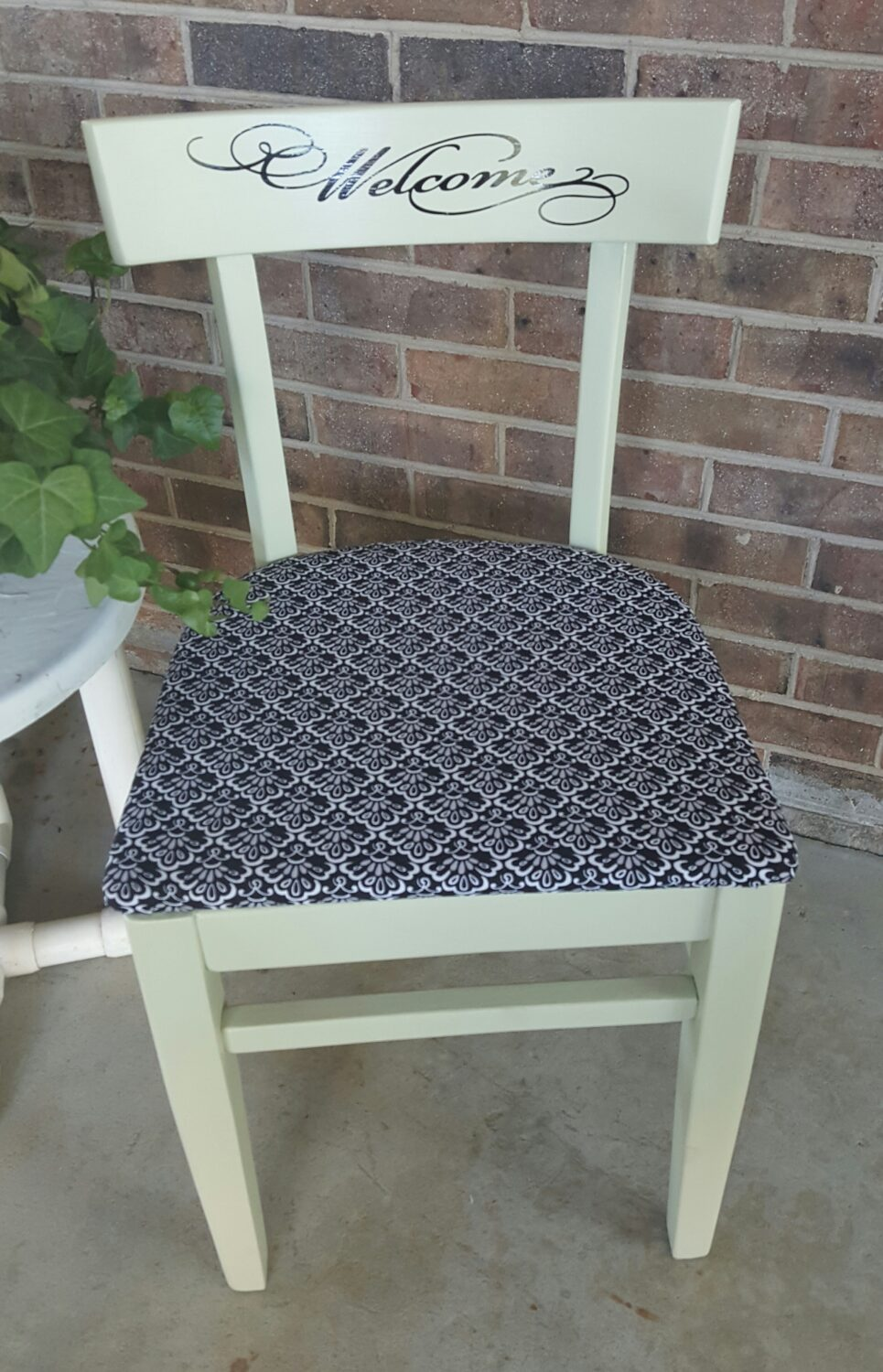 "Affordable DIY Project: Yard Sale Leftover Turned Into Charming ""Welcome"" Chair for Under $10"